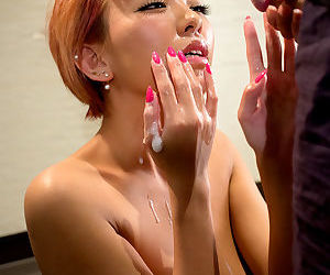 Tiny Asian redhead enjoys the sticky attentions of her male benefactor