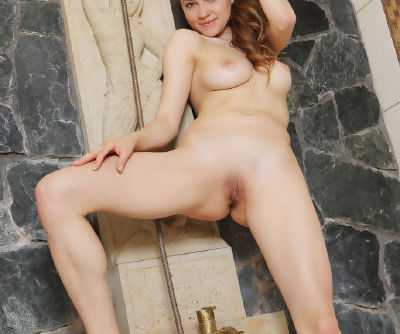 Sweet Pandora B undresses in the bathroom to play with the shower hose naked
