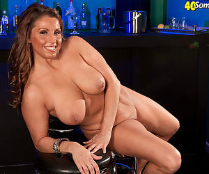 Older plumper Stacie Starr removes her dress for nude posing in a bar