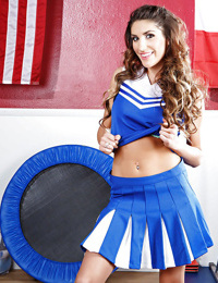 Uniformed cheerleader August Ames is showing her hot body while dancing