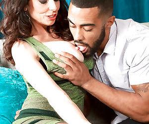 Buxom over 50 mature MILF Karen Kougar giving big cock interracial blowjob