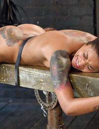 Short haired black girl Skin Diamond receiving painful flogging of buttocks