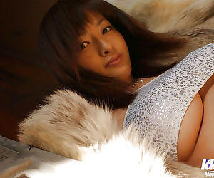 Asian babe Sakura Shiratori uncovering her big melons and unshaven pussy