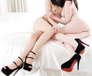 Three Japanese girls in high heels and no clothes hump each other