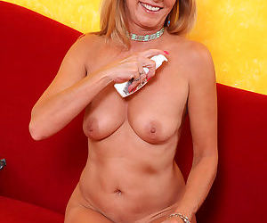 Blonde mature hottie Jessica Sexxxton squeezes her small tits and fingers twat