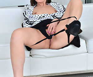 Fantastic brunette mom strips down and spreads her wet pussy