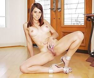 Naughty Latina mom Eva Long showing off her hot shaved pussy