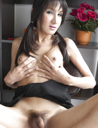 Young ladyboy Gisele looking sexy in pigtails while spreading legs