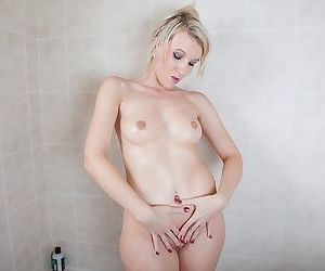 Cute blonde mommy masturbating shaved cunt with shower head in toilet