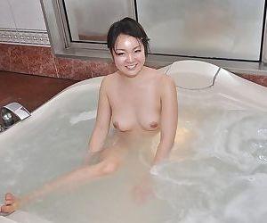Smiley asian cutie with perky titties Mina Terashima taking bath