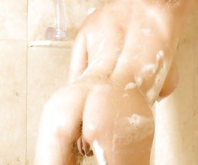 Rachel teases her milf pussy while it is oiled and wet in the shower