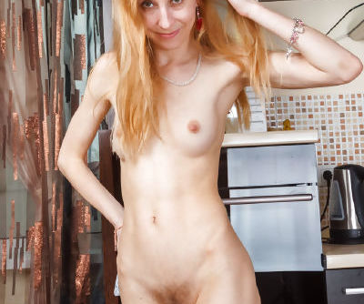 Skinny older redhead Kler undresses in kitchen to play with her beaver