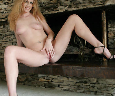 Redhead MILF Katrena Starr sheds lingerie to play with her snatch