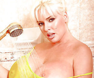 Older blonde pornstar SaRenna Lee showing off big wet tits in shower