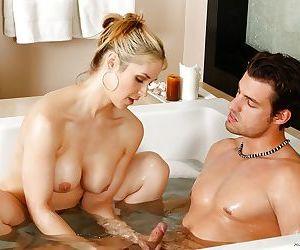 Busty blonde mom Sarah Vandella giving husband a handjob in bathtub