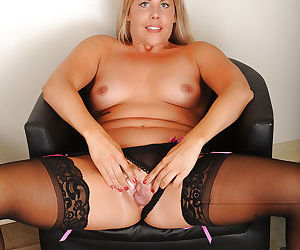 Older blond Kayla Larson shows off her fat butt in stockings and garters