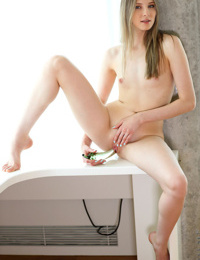 Young coed Nimfa gets naked in the window to toy her horny snatch