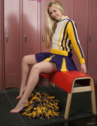 Blonde cheerleader bends over in uniform to show hot ass in the locker room