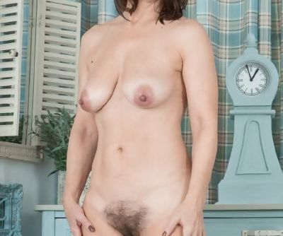 Older mature slut strips right down to her saggy melons and hairy beaver
