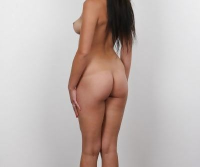 Brunette amateur Nikola loses her long skirt on way to posing in the nude