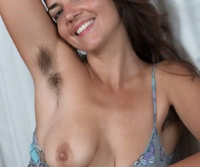 Amateur Katie Z licks her furry armpits before parting her beaver wide open