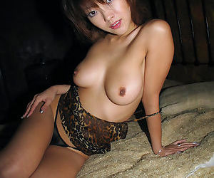 Slutty asian cutie with nice jugs fucks and sucks off a hard cock