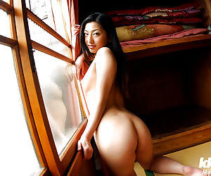 Graceful asian babe Ran Asakawa slipping off her lingerie