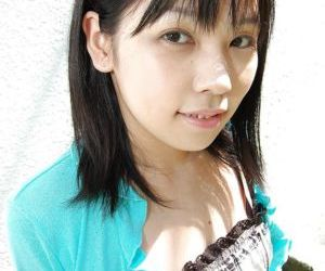 Asian teen Minami Ozaki getting naked and exposing her unshaven cunt