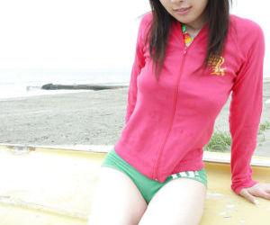Lustful asian teenage babe showcasing her big knockers outdoor