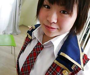 Asian schoolgirl Mayu Nakane revealing her nice ass and inviting gash