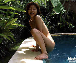 Sexy asian babe Madoka Ozava stripping off her clothes outdoor