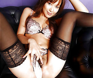 Busty asian babe in stockings Yua Aida slipping off her lingerie