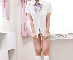 Cutie Asian girl lifts her uniform skirt to flash panty upskirt and show pussy