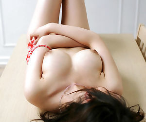 Hot asian babe Takako Kitahara uncovering her big tits and hairy pussy