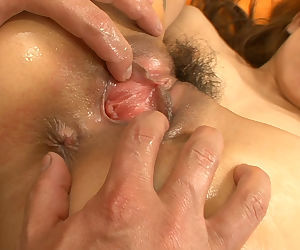 Japanese chick Nozomi Uehara gets oiled up before having her pussy toyed