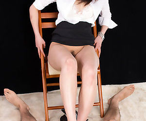 Japanese office worker with great legs hikes her miniskirt to masturbate