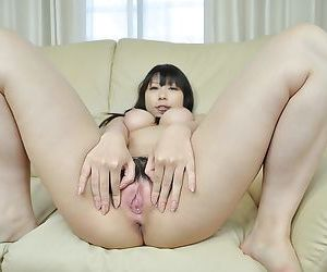 Asian cutie strips down and gets her hairy cunt stuffed with a vibrator