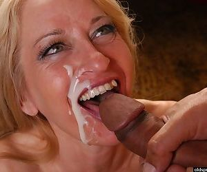 Aged blonde in hose and denim skirt takes facial cumshot after giving bj