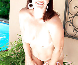 Aged pornstar wife Victoria Miller sheds bikini outside before masturbating