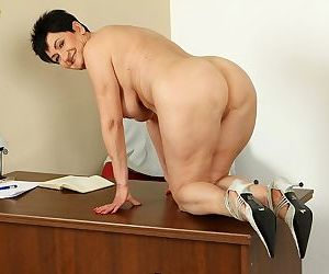 Mature and sexy office whore Karoline makes everybody see her old cunt