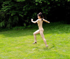 Sweet asian teen babe with tiny tits posing naked and having fun outdoor