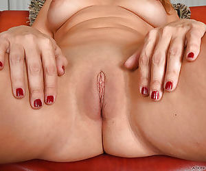 Leggy mature solo girl Stevie Lix spreading shaved pussy in high heels