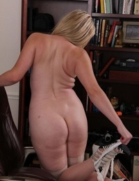 Older chick Lexi Moore takes everything off except her sexy stockings