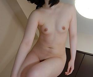 Smiley asian lovely Arisa Maeda undressing and spreading lower lips