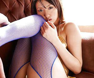 Sweet asian babe Misa Shinozaki posing in sparkly bikini and pantyhose