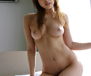 Pretty asian babe Yua Aida exposing her voluptuous curves and getting wet