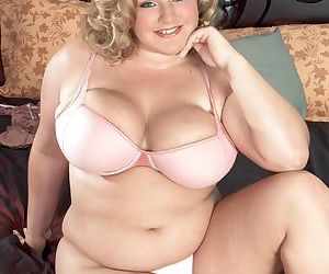Obese blonde chick Veronica Vaughn whips out huge boobs prior to masturbating