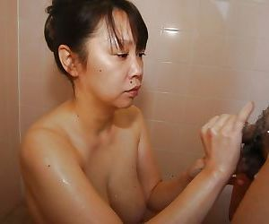 Naughty asian MILF with chubby curves goes down on a swolle cock