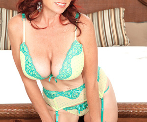 Busty redhead mom in sexy lingerie Karen Kougar blows off a horny stud