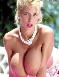 Glamorous hot blonde Tiffany Towers suns her enormous knockers on the patio